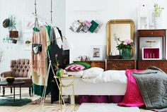 love the hanging clothing and magazine storage.
