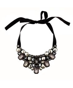 Bib necklace. i inherited this same EXACT one, except with a skin-color ribbon :)