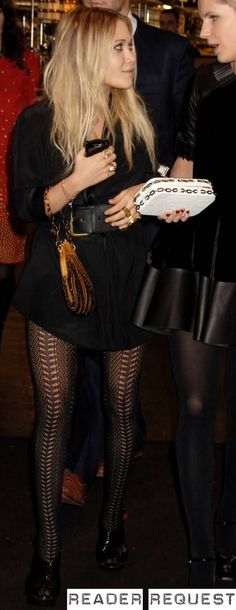 Mary-Kate Olsen in a shirt dress, large black belt and black pattern tights.