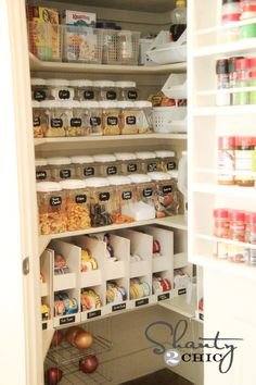 Organized pantry with chalkboard labels - I don't like the chalkboard labels, but I love the can racks
