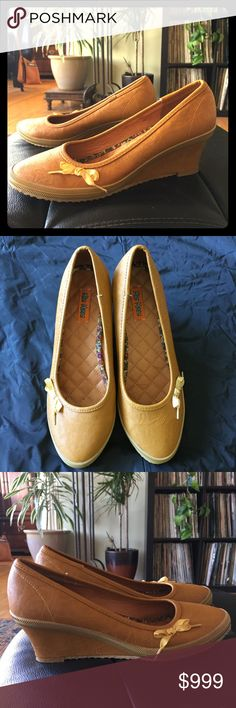 Miz Mooz Yellow Brick Road Leather Slip-On Wedges Excellent condition. worn once.  Black number on bottom heel in permanent marker- my sis thought they were for her garage sale but I saved them in time. Leather lining. Manmade materials. Cushioned insole. Miz Mooz Shoes Wedges