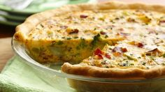 Made this tonight and it was really good! kids even ate it.....not realizing it was full of veggies.  i used a mixed bag of frozen veggies instead of the cheesy potato veggie mix it calls for.  also used 2% milk instead of whipping cream.     Perfect for supper or brunch, this hearty quiche can be made in just minutes with frozen vegetables and refrigerated pie crusts.