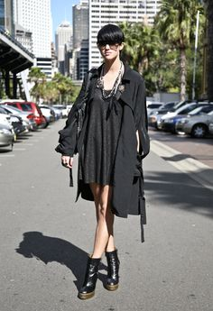Streetpeeper.com Street Fashion Coat: Black DION LEE Coat Dress:  Black MANNING CARTELL Dress Shoes: Black YSL Boots Bag: Black BALENCIAGA Bag Sunglasses: MARC BY MARC JACOBS Sunglasses Photo By: Phil Oh