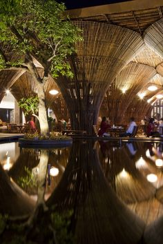 The Kontum Indochine hotel in Vietnam consists of fifteen conical bamboo columns to support the roof designed by Vo Trong Nghia Architects. by green_initiative Bamboo Architecture, Amazing Architecture, Contemporary Architecture, Interior Architecture, Architecture Awards, Interior Design, Vietnam, Bamboo Building, Bamboo Structure