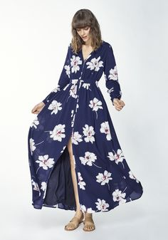 Indulge yourself in our winter bloom maxi dress, featuring a V neck, button down front and a front split for extra glamour. The dress also features a flattering gathered waist and a lined body/skirt. Pair with heels for a glamorous party style.