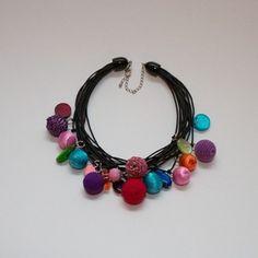 An example of her jewelry - beautiful jewel tones