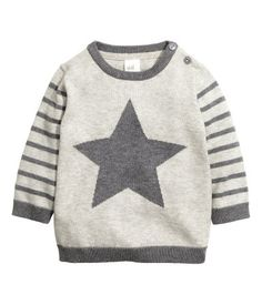 Fine-knit, long-sleeved sweater in soft cotton fabric with buttons on one shoulder.