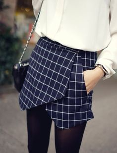 .Check Skort with a cream blouse and cut out leather booties = stunning