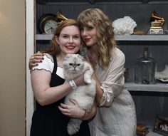 Taylor Swift at her house in Rhode Island with her cat and a fan on October 19th, 2017