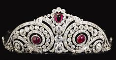 Cartier Jewels | diamond swirl tiara with cabochon ruby accents, made by Cartier.