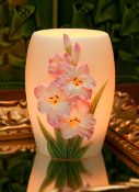 """Gladiolus memory lamp is hand painted and made of bonded marble. The gladiolus are raised and offer wonderful detail. The gladiolus are white, with fuchsia toward the outer edges. The stamen are purple and faint yellow. The stems are a beautiful brushed green. The colors on this accent lamp are elegant and pleasing to the eye. This night lamp makes a wonderful gift alternative to flowers. 4""""W x 5.25""""H - Max.15 watt bulb, which is included."""