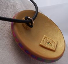"""Jump ring Bail held stationary to cord  by friction with """"O"""" ring. With Smaller cord or ribbon use 2 """"O"""" Rings - Keeps Clasps from sliding to the front."""