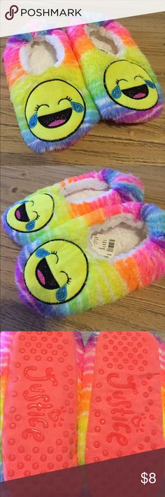 New kids emoji slippers My daughter ordered these from Justice. They are slightly too small for her and she is a 6.5 ladies. Would fit slightly smaller. She took the tag off to try them but they are new never worn and the tag is inside the shoe. Justice Shoes Slippers