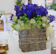I love the blue and green flowers on the top for ideas in ball mason jars though