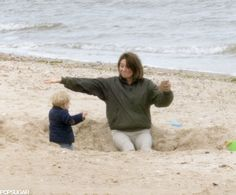 Prince George Makes Kate Middleton's Mom Smile as He Plays in the Sand