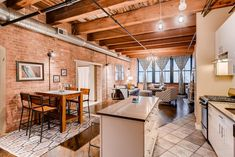 Modern open concept loft space with exposed brick exposed wood beams exposed d Modern Loft Apartment, Loft Apartment Decorating, Chicago Apartment, Rustic Apartment, Loft Apartments, Brick And Wood, Wood Beams, Looking For Apartments, White Subway Tile Backsplash