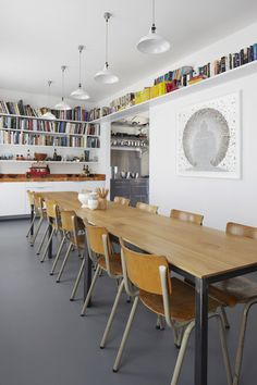 shelving + white pendants + vintage chairs and table