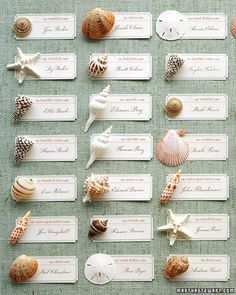 Instead of numbers to assign guests their tables, use names of seashells. Each type of shell represents a different table. Arrange seating cards and shells on aqua fabric to give the impression of water. On each table, display a card with the shell's name, or fill a bowl with those shells as a centerpiece.Seating Cards How-To:Make simple rectangular tags on a computer (ours have coral-color words and aqua borders). For notched corners, clip with a 1/4-inch hole punch. Apply an adhesi...