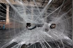 This masterpiece man-made Giant Spider Web made from Packaging Tape is an incredible piece of art that everyone must see at the Vienna Stock Exchange Tape Installation, Art Installations, Interactive Installation, Stylo 3d, Spiderman, Instalation Art, Giant Spider, Spider Webs, Spider Silk