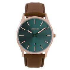 Armbanduhr mit braunem Lederarmband.  https://www.uhrcenter.de/uhren/dukudu/damenuhren/dukudu-thora-damen-armbanduhr-braun-du-119/