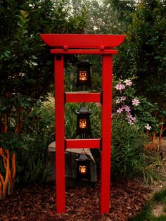 """Botanical Towers can be painted or stained to match any decor. Eastern Red Cedar complimented by cast iron brackets made from 100% recycled content. 72"""" X 22"""" installed, creating three 15"""" X 15"""" display windows. Three lanterns to create a warm welcome along a garden path, or perhaps a bird sanctuary, with birdhouse, feeder, and bath"""" www.botanicaltower.com"""