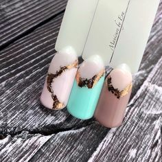 Pastel pink mint nude nails with gold foil