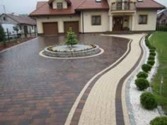 A statement driveway as a continuation of the fabulous home style. this can be created with Holland pavers in (Red / Charcoal) using tan as the designated walkway. Front Driveway Ideas, Driveway Design, Driveway Landscaping, Outdoor Walkway, Backyard Patio, Front Garden Landscape, Landscape Design, Stained Concrete Driveway, Pavement Design