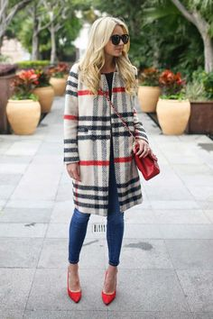 Insert color into the last dreary weeks of winter with a checkered coat and red accessories.
