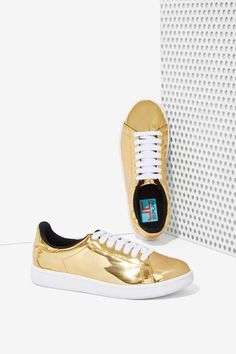 You're about to get a kick out of these gold metallic sneakers by JC Play by Jeffrey Campbell.