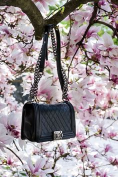 Chanel bag, only they can make a bag look this good with all those flowers!