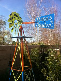 I painted my ugly ole metal windmill that sits above my garden box!
