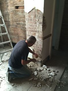 Exposed brick chimney in the kitchen