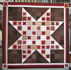 Stars in a giant star quilt, red and brown / tan colors.  From Cupcakes 'n Daisies: Nottingham Star