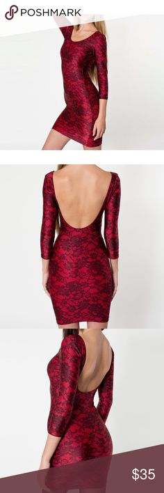 AMERICAN APPAREL Lace Print 3/4-sleeve Dress Sleek and sexy mini in their comfortable and slimming nylon tricot. This bodycon dress features quarter length sleeves and a deep scoop back with floral lace print. Can be dressed down for casual wear or dressed up for club/cocktail wear. Color: Red with black lace print Material: Nylon Tricot (80% Nylon / 20% Elastane) Nylon Tricot is a stretchy, shiny fabric that's smooth and of medium thickness. TRADING PAYPAL American Apparel Dresses Mini
