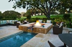 Outdoor Inspiration: Stunning Design Ideas For Fireplaces By The Pool | by Pool Environments | Biokominki www.ambusto.pl