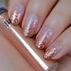 Natural nails paint with colorless nail polish, pour glitter you have prepared on the nail, most put on top and with a special brush drag them down. Above rhinestones put one layer of clear nail polish again and you are ready.