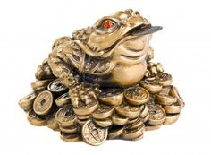Chinese-feng-shui-frog-with-coins-isolated-on-white.