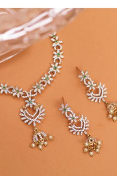 Flaunt your true self with this sleek and simple CZ necklace set. Curated with high quality CZ stones, traditional and floral motifs this delicate necklace defines perfection at its best to ensure you dazzle like a star. Indian Jewelry Sets, Indian Jewellery Design, Jewelry Design, Necklace Set, Pearl Necklace, Cz Stones, Summer Jewelry, Floral Motif, Jewelry Collection