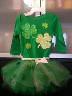 $3 green onsie with foam glittered shamrocks glued on and a green and white tutu