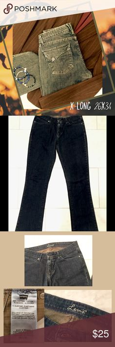 LEVI'S XLong 26x34 Straight Leg Medium Wash Jeans Super long and lean!  2 front pockets, 2 covered snap closure rear pockets.  Fabric is 99% cotton, 1% elastane, giving jeans just a bit of stretch.  Medium wash color, excellent used condition - no stains or tears. Levi's Jeans Straight Leg