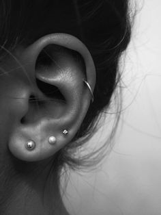 Triple lobe piercing with helix piercing.