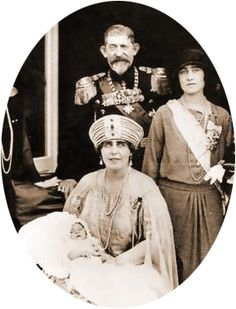 King Ferdinand and Queen Marie of Romania. photographed in 1926. The Queen (seated centre)is holding Prince Peter of Yugoslavia. The woman standing right is The Duchess of York mother of Queen Elizabeth II of the United Kingdom.