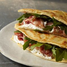 Throughout the towns of Emilia-Romagna are little food stands, where piadina (flat bread) is grilled to order and sandwiched around a variety of filli...