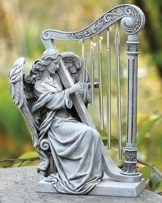 Angel With Harp Figure For Garden Patio Or Home The beloved image of angels playing harps in heaven probably originated from the Bible's description of a vision of heaven in Revelation chapter 5. In t