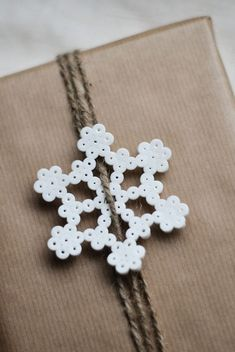 Hama bead snowflake for gift wrapping Hama Beads Design, Hama Beads Patterns, Beading Patterns, Noel Christmas, Winter Christmas, Christmas Ornaments, Hama Beads Christmas, Xmas, Christmas Stockings