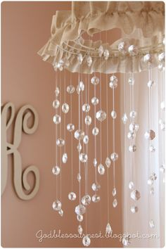 Cute and inexpensive idea for chandelier under archway---Maybe use cloud for a boys room