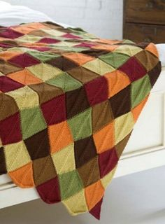 A myriad of autumn colors adorn this classic knit afghan pattern. Perfect for adding warmth to any room in the house, the Falling Leaves Afghan is the quintessential blanket for Thanksgiving festivities.