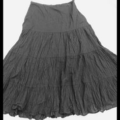 Solid Black Witch Skirt ? There is indeed an edit that's a black & white filter because for some reason it shows up slightly blue on camera. It is a size medium and fits true to size. No flaws or stains. Very ruffled and flowy. Skirts Maxi
