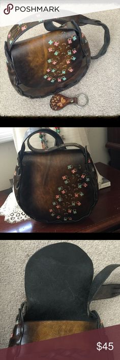 """Beautiful Dark Brown Tooled Leather Crossbody Bag Beautiful truly vintage medium-small dark brown distressed, hand tooled leather with painted floral cross body and matching leather key ring - Hippie and Bohemian in style - Very well made with braided crossbody strap - Bag approximately 8-1/2 by 8-1/2 with a 15"""" drop -  — Circa 1970's - Please expect minimal surface wear, marks and or scratches as this is pre-owned, loved and worn - However no major damage to note Vintage Bags Crossbody Bags"""