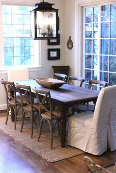 This light, this dough bowl, this rug! A rustic dining room